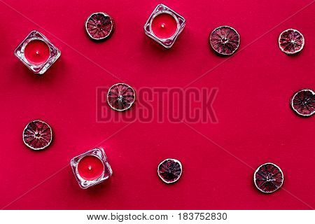 romantic dinner in red color with candles and blood orange top view mockup