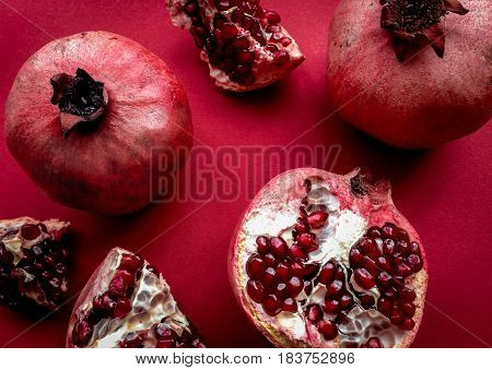 romantic dinner in red color with cut pomegranate top view