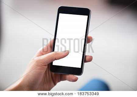 Close-up Of Hands Holding Cell Phone With Blank Screen