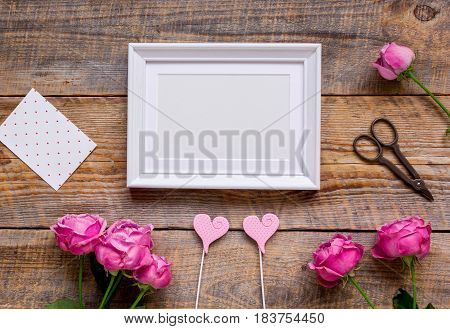 Mother's day gift with peony flowers, cards and frame on wooden background top view mockup