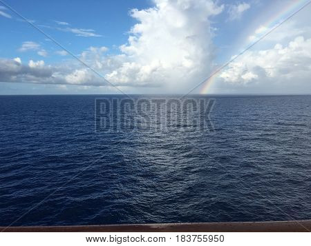 Beautiful rainbow in the middle of the ocean