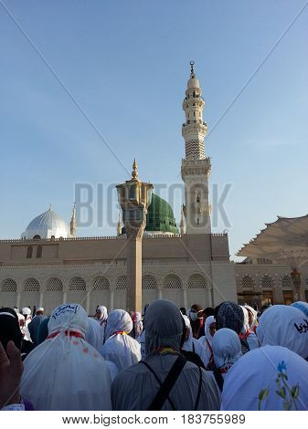 MADINAH, SAUDI ARABIA - AUGUST 19: Malaysian women pilgrims assembled in front of the green dome for a group visit of Prophet Mosque on August 19, 2015 in Medina, Saudi Arabia.