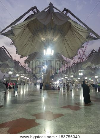 MADINAH, SAUDI ARABIA - AUGUST 20: Partially opened of an electronic umbrellas at Prophet Muhammad Mosque on August 20, 2015 in Madinah, Saudi Arabia.