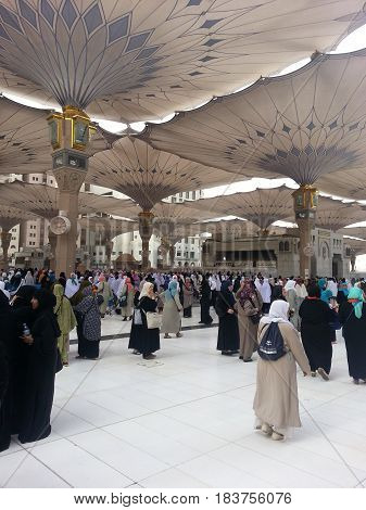 MADINAH, SAUDI ARABIA - AUGUST 18: Pilgrims under the electronic umbrellas at Prophet Muhammad Mosque on August 18, 2015 in Madinah, Saudi Arabia.