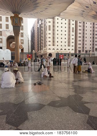 MADINAH, SAUDI ARABIA - AUGUST 18, 2015: Muslim pilgrimage at Masjid An-Nabawi also known as the Prophet Mosque is second holiest site in Islam.
