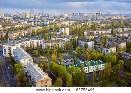 The aerial View of urban residential district in KyivUkraine in spring.View over the city rooftops with sunlight at Darnitsa suburb.Moderns buildings at Industrial uptownresidential neighbourhood.