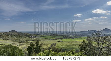 Kamyk village and ruin of castle in north of Bohemia in spring sunny day