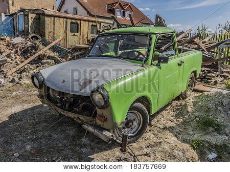 Old bakelite green car in sunny nice day in Kamyk village