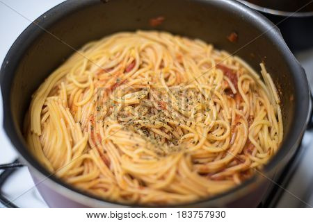 Delicious Pot of Pasta with Tomato sauce and basil on top