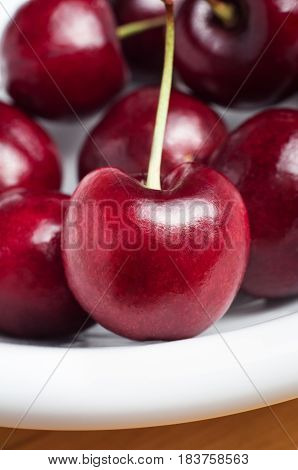 Red Cherries With Stems On White Plate