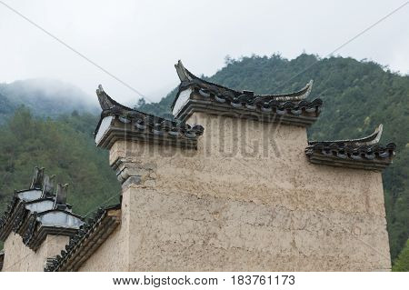 roof of historic building against green mountainshot in LishuiChina.