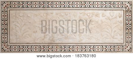 AGRA, INDIA - FEBRUARY 14 : Mughal stone art on the facade of the Taj Mahal (Crown of Palaces), ivory-white marble mausoleum on the south bank of the Yamuna river in Agra, India on February, 14, 2016.