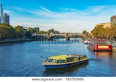 Cruise Boat With Tourists On Yarra River On Sunny Day