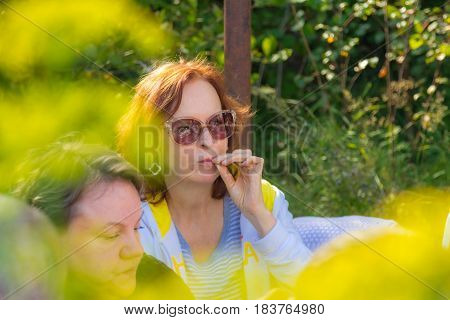 Portrait of a woman in glasses on the nature