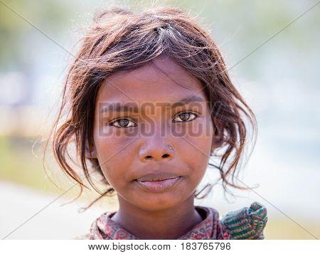 HIMALAYAS ANNAPURNA REGION NEPAL - OCTOBER 23 2016 : Portrait nepalese child on the street in Himalayan village Nepal