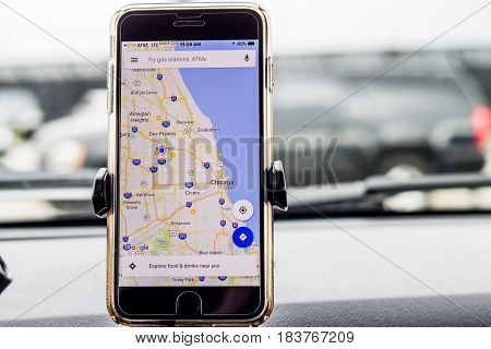 Chicago,IL,USA,Feb-21,2017,Smartphone attached to a car mount in car with Google map (for editorial use only)