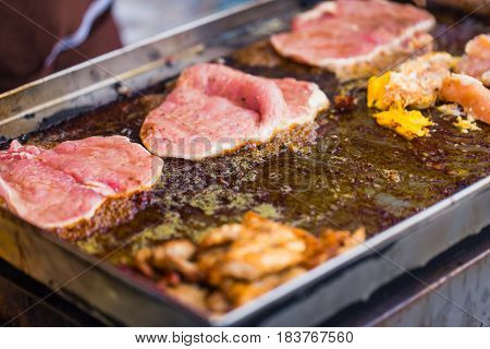 Street Food In Thailand. Pork Cook With Butter Oil On Hot Plate.