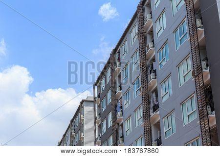 new clean condominium. apartment building against blue sky