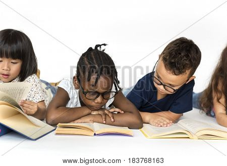 Group of school kids reading for education