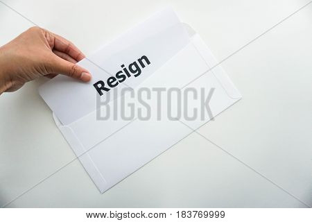 business concept of isolated woman hold resignation letter in left hand