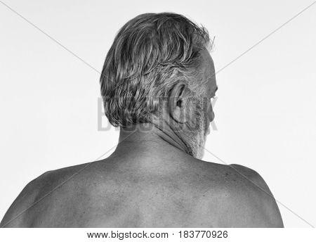 Senior caucasian man shirtless studio shoot