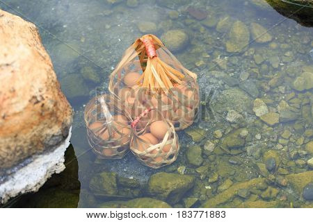 Natural Boil Eggs For Mineral Food, Boiling In Nature Hot Water With Basket. Boiled In Hot Springs.