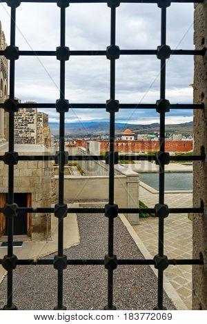 View Through The Grate Of Rabati Castle In Akhaltsikhe, Georgia