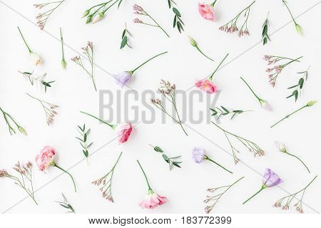 Flowers composition. Pattern made of various flowers and eucalyptus branches on white background. Flat lay top view