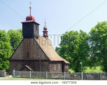 Old Wooden rural chapel with cemetery