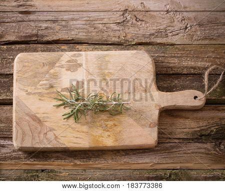 the rosemary on a old wooden background