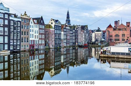 Inner Harbor Old City Boats Reflection Old Houses Church Amsterdam Holland Netherlands. Center of the City