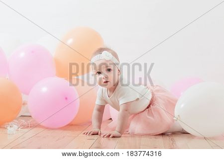 the beautiful little girl with balloons indoor