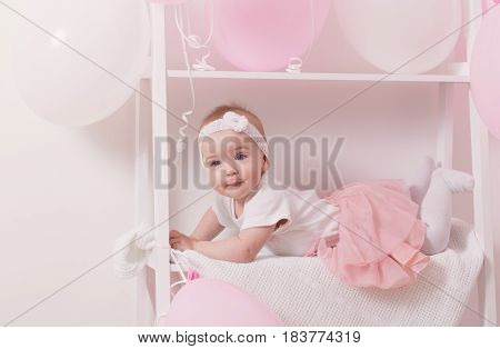 the beautiful little girl with pink  balloons