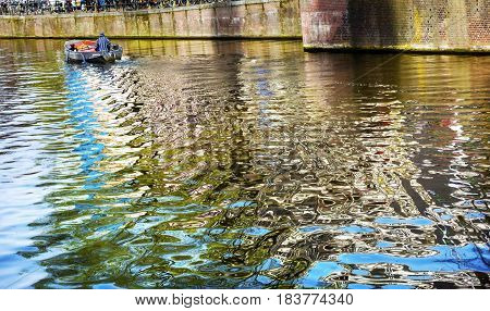 Boat Reflection Singel Canal Amsterdam Holland Netherlands. Canals in Amsterdam create beautiful abstract reflections.