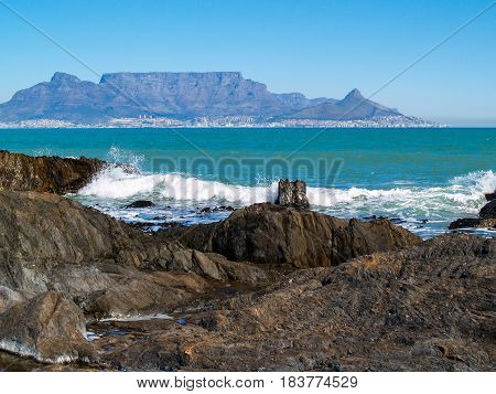 Capetown's scenic Table Mountain across blue waters of bay