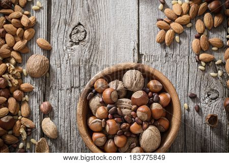 the mixed nuts on old wooden background