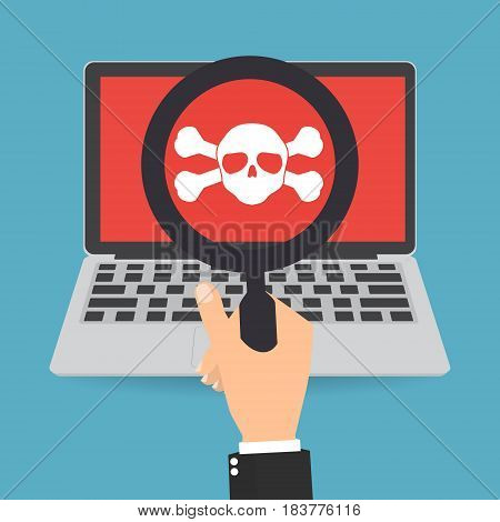 Businessman hand with magnifying glass with skull crossbones logo on laptop screen on red background.Concept of network security or computer virus.