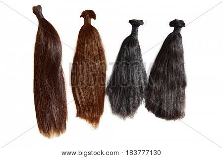 Pigtail hairs donation to cancer patient isolated on white background