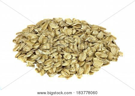 Dry oat flakes on the white background