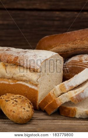 Close-up of various bread loaves with slices