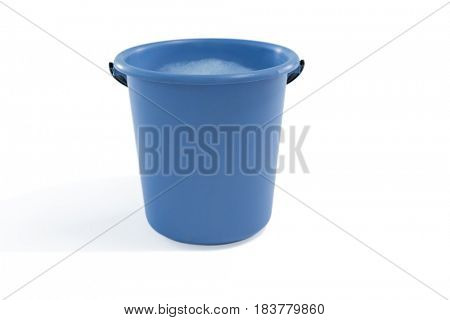 Close up of bucket containing soap sud against white background