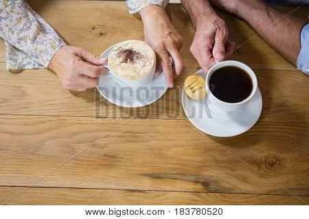 Senior couple having coffee in café