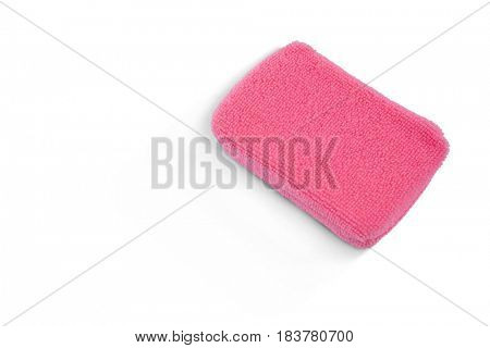 Close up of pink bath sponge against white background