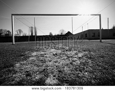 Hang Bended Blue Yellow Soccer Nets, Soccer Football Net. Grass On Football Playground In The Backgr