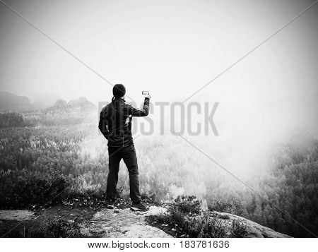 Amateur Photographer Prepare Camera To Takes Impressive Photos Of  Misty Fall Mountains