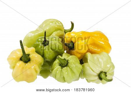 Vegetables of small yellow and green chili pepper habanero isolated on white background