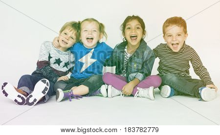 Young children sitting and having fun