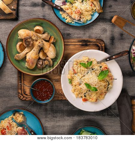 Variety of Italian food on wooden table top view