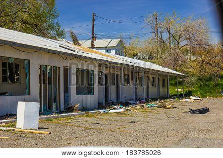Abandoned Motel Units Vandalized With Broken Glass & Trash