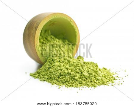 Matcha tea flipped from the wooden bowl.